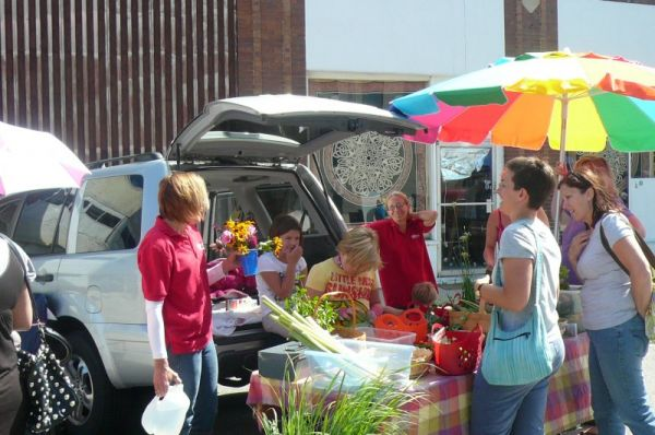 Selling produce at the farmers market