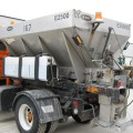 Snow plow truck with salt/sand hopper
