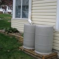 My wonderful husband constructed this rain barrel station just in time for the 2010 monsoon season!
