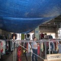 Clothing at Together Inc. being sorted by Seven Days of Service volunteers.