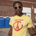 """A t-shirt reading """"End a War"""" with a peace sign at the Concert for Equality"""