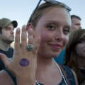 A fan proudly displaying her Waiting Room stamp