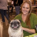 Jenny Olive from Power 106.9 poses with her pug