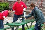 Omaha volunteers paint picnic tables in Hanscom Park
