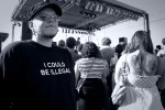 "I concert goer with a t-shirt reading, ""I Could Be Illegal"""