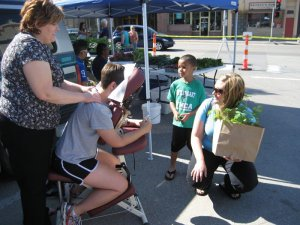 Christy Pooschke enjoys a free massage at the market!