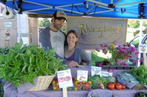 Matt and Terra selling their chemical-free produce from Rhizosphere Farm