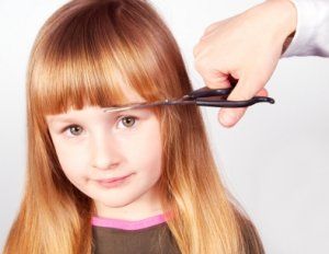 Girl getting her bangs cut