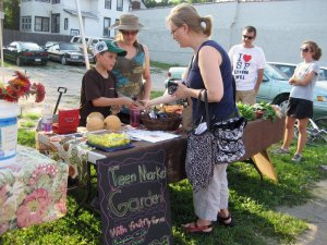 Julian Weak sells melons + jams at Gifford Park Market with mentor Cynthia Shuck
