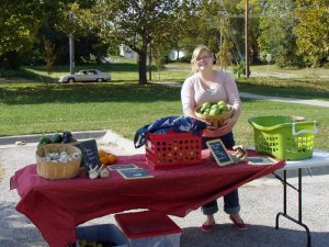 Nicole Engels sets up a produce stand